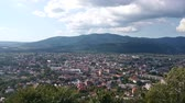 panorama view on a little town at the valley in the mountains with cloudy sky Stock Footage