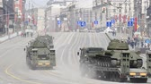haki : MAY 09, 2015 MOSCOW Military machinery moving through Tverskaya street during Victory Day parade. Tanks on the road. Stok Video
