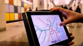 Бостон : MAR 28, 2018, BOSTON, USA: Man in underground examines the subway map of Boston using the tablet computer. Стоковые видеозаписи