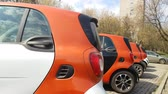 sity : APR 30, 2018, MOSCOW, RUSSIA: People testing carsharing car on the street. New business in Russia. In 2017 organised 8 carsharing company in Moscow.
