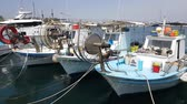 док : MAY 22, 2018, PAPHOS, CYPRUS: Small Fishing Boats In Paphos Harbor, Mediterranian sea, Cyprus.