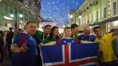 возбужденный : JUN 16, 2018, MOSCOW, FUSSIA: Iceland and Brasilian funs with national flag on the street