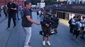 liga : JUN 16, 2018, MOSCOW, RUSSIA TV operator filming Funs plays soccer in the street