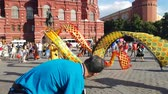 timeless : JUN 27, 2018 MOSCOW, RUSSIA: Artists from China doing Dragon dance in the center of Moscow. Chinese Ribbon Dancer Performing In Traditional Costume Outdoors. Stock Footage