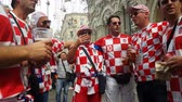 hırvatistan : JUN 16, 2018, MOSCOW, RUSSIA: Croatian funs having fan on the street. People in national soccer team wear posing and dancing for photographer in Moscow