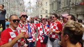 tým : JUN 16, 2018, MOSCOW, RUSSIA: Croatian funs having fan on the street. People in national soccer team wear posing and dancing for photographer in Moscow