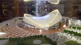 katar : JUL 10, 2018 MOSCOW, RUSSIA: Model of Khalifa International stadium in Qatar show room. Qatar is the country of World Soccer Championship 2022.