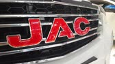 letras : Close-up JAC motors logo in mims 2018 exposition. JAC motors is the famous automobile factory from China. SEP 03, 2018 MOSCOW, RUSSIA Vídeos