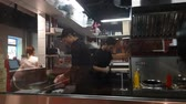 Chefs at the glass in the modern Chinese cafe. SEP 21, 2018 MOSCOW, RUSSIA