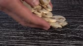 group of objects : A man pours a bunch of chopped champignon mushrooms on a black wooden table. Cooking vegetables in a restaurant and at home Stock Footage