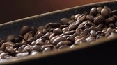 coffee break : Coffee beans rotate on the pan Stock Footage