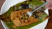 bazylia : grilled flower crab with curry paste in banana leaf scooping by silver fork