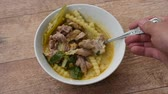 curry : spoon scooping boiled chicken with coconut shoot in curry on bowl Stock Footage