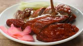 rode paprika : roasted duck meat and pickled ginger dressing sweet sauce on plate