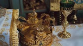 nupcial : Church attributes for wedding ceremony. Gold crowns are on the altar. Attributes of priest. Interior of church Stock Footage