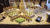 macaroons : Tasty wedding reception candy bar dessert table inside celebration hall