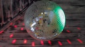 hetvenes évek : Beautiful Disco Ball Spinning Seamless with Flares on Background.