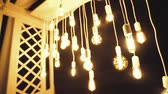 veranda : Lamps close up. Wedding garlands that glow on the arch. Vespers Wedding Ceremony Stockvideo