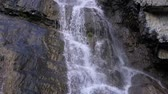 Waterfall close up, the water falls and flows through the rocks panorama Dostupné videozáznamy