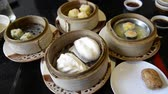 shu : Unknown people eat Steam dumpling eating top view point of many kind of traditional steam dumpling Chinese food such as steam bun dumpling or Dim Sum for etc.