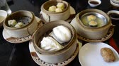 shu : Unknown people eat Steam dumpling eating top view point of many kind of traditional steam dumpling Chinese food such as steam bun dumpling Dim Sum Time-lapse.