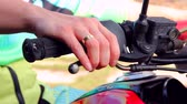 рычаг : Closeup shot of a bikers hand on the right grip of the motorcycle pressing the front wheel brake lever. Стоковые видеозаписи