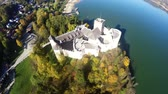 battlements : Aerial footage of Niedzica Castle at Lake Czorsztyn in Poland