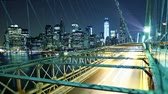 Time lapse of city traffic on Brooklyn bridge at night. Loopable