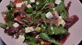 rúcula : A plate with the spanish cheff salad with goat cheese, jamon and green rucola
