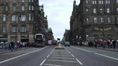 estuary : August 2017: Cars, buses and taxis cross the North Bridge. August 2017 in Edinburgh Stock Footage