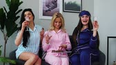 pajamas : Slumber party before the wedding, three bridesmaids drinking champagne and eating candies. talk about men.
