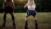sportwear : Group training kangoo. Three girls at sunset perform dynamic squats aimed at slimming and strengthening the muscles of the thighs