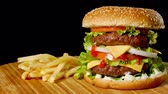 wood grill : Craft beef burger and french fries, sauce isolated on black background. fast food