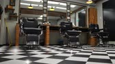 fotel : Vintage hanging lamps in hairdressing salon. Ceiling retro lamp in barber shop. Barber pole. Hair salon interior. Metal ceiling lights in barbershop