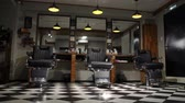 görüntüler : the camera on the Steadicam shows the interior of a Barber shop with a beautiful design. Stok Video