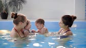 suckling : Group of mums with their baby children at infant swimming class