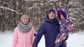 piggyback : Happy family at sunset. Father, mother and two children daughters are having fun and playing on snowy winter walk in nature. The child sits on the shoulders of his father. Frost winter season. Stock Footage