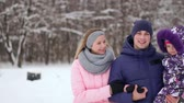 meeliften : Family Having Fun Snowy Woodland Stockvideo