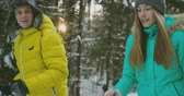 oddech : A married couple is skiing in the forest practicing a healthy lifestyle. Slow motion