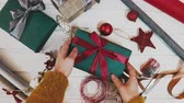 doar : Top view of woman hands with gift box on wooden table.