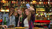 collega : In the Bar or Restaurant Hispanic man Takes Selfie of Herself and Her Best Friends. Group Beautiful Young People in Stylish Establishment