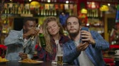 addio al celibato : Happy male friends taking selfie and drinking beer at bar or pub. People, leisure, friendship, technology and party concept - happy male friends taking selfie. Filmati Stock