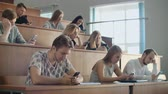 accademia : Multi Ethnic Group of Students Using Smartphones During the Lecture. Young People Using Social Media while Studying in the University.