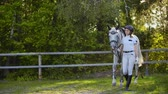 eyer : Walk in the horse club from female and horse. Slow motion Stok Video