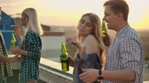 tenisky : Young couples are dancing on the roof party