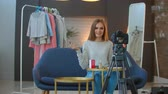 stella cadente : female fashion blogger recording make up tutorial to share on social media in vlog.