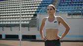 ligne de depart : Slow motion portrait of beautiful woman running on the stadium bleachers with concentrated deep breathing and motivating myself and consciousness for the race. Discard unnecessary emotions