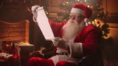 papyros : Santa Claus holding old scroll of parchment, . Letter, blank. Smiling Santa with scroll paper. Santa list- Santa Claus holding scroll paper Videos