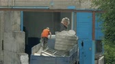 metal powder : Two handymen are working in the back of a truck. Workers prepare to unload cargo. Stock Footage