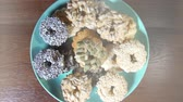 estanho : cookies with nuts on a plate, rotation close-up